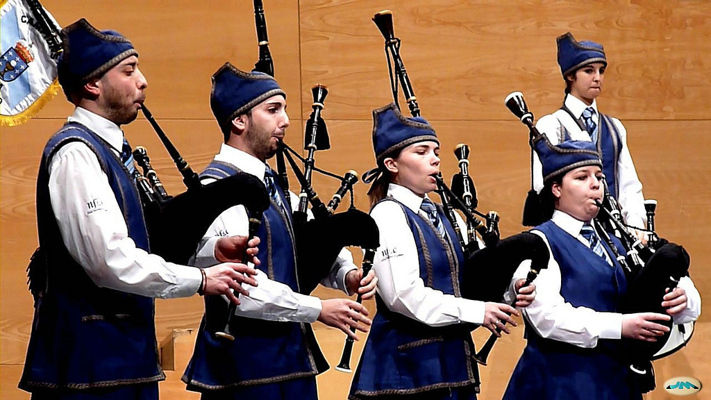 men and women spanish bagpipers